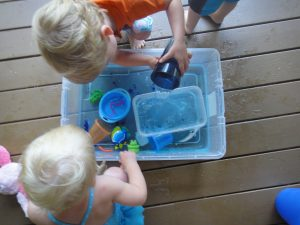 kids playing in sensory tub